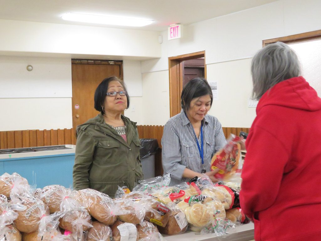 Knox Foodbank distribution 2 women and guest 2019 smaller for website