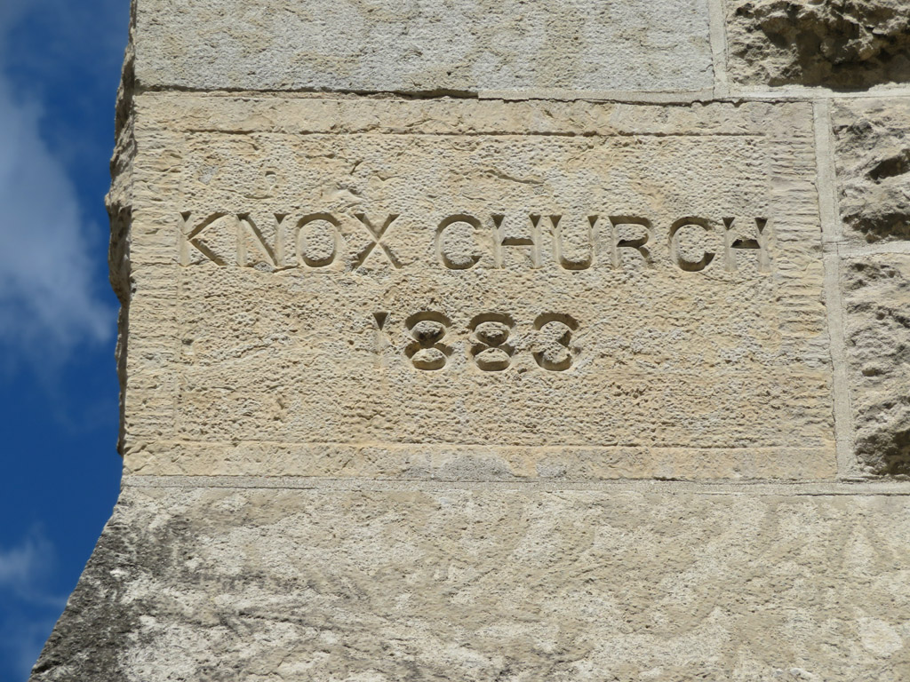 The cornerstone from the 3rd Knox building is on the southwest tower.